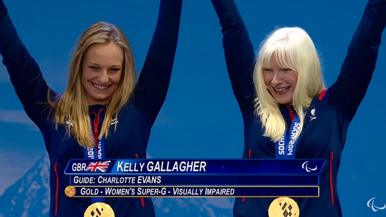 YouTube Screenshot image of Charlotte Evans (left) and Kelly Gallagher (right) at the Day 3 Victory Ceremonies in Sochi 2014 Paralympic Winter Games.